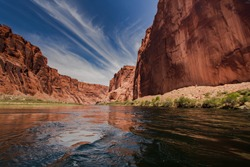 colorado river with gorgeous sandstone walls and canyons