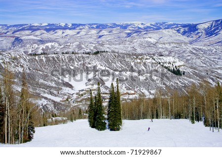 Colorado Ski Slope: The Rocky Mountains offer a panoramic view to skiers on a sunny day in Colorado.