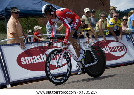 COLORADO SPRINGS, CO - AUG 22: Professional cyclist  Christopher Baldwin rides the prologue course of the 2011 USA Pro Cycling Challenge in Colorado Springs, USA on Aug 22, 2011 - stock photo