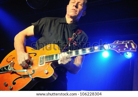 COLORADO SPRINGS, CO. USA	JANUARY 27:		Vocalist/Guitarist Jim Heath of the Rockabilly band The Reverend Horton Heat performs in concert January 27, 2012 at the Black Sheep in Colorado Springs, CO. USA