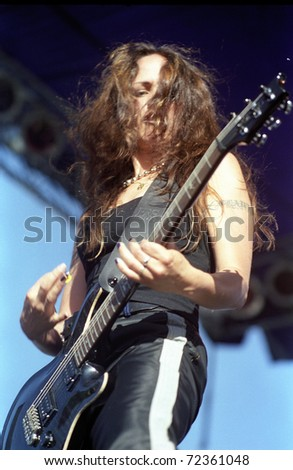 COLORADO SPRINGS, CO. USA - JULY17:Guitarist Flavia Canel of the all female Heavy Metal band Drain STH performs in concert July 17, 1998 at a music festival in Colorado Springs, CO. USA