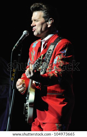 COLORADO SPRINGS, CO. USA	MARCH 12:		Vocalist/Guitarist Chris Isaak of the Blues Rock band Chris Isaak performs in concert March 12, 2012 at the Pikes Peak Center in Colorado Springs, CO. USA