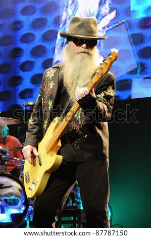 COLORADO SPRINGS, CO. USAOCTOBER 11:Bassist/Vocalist Dusty Hill of the Blues Rock band ZZ Top performs in concert October 11, 2011 at the Pikes Peak Center in Colorado Springs, CO. USA - stock photo