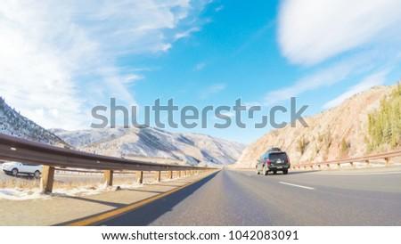 Colorado, USA-December 26, 2017. POV point of view - Driving through Mountain terrain in the Winter. #1042083091