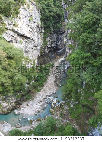 Colore, Bergamo, Italy. Dezzo creek at the bottom of steep rock cliffs and mountain ravine. Shoot from Via Mala an historical route in Scalve Valley #1153312537
