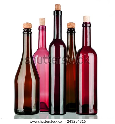 Colored alcohol bottles on a reflective surface with white background #243254815