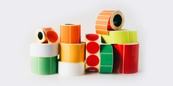 Colored and white reels with self-adhesive labels for printers