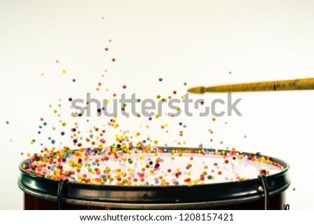 Colored balls bounces off drum in shockwave pattern. White backg stock photo