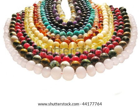 colored beads made of different kinds of natural jewels