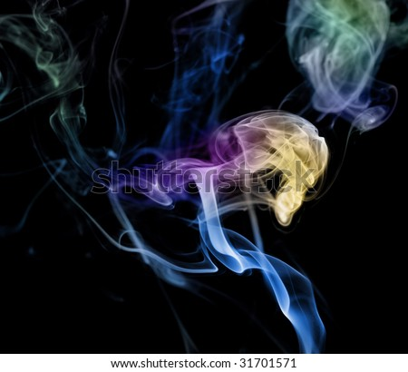 Colored blue yellow green smoke slowly flow isolated in studio