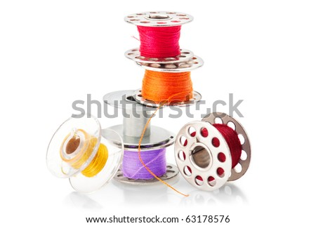 Colored bobbins for machine sewing isolated on white background