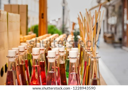 Colored bottles of fragrances with sticks for the fragrance of the house. #1228943590