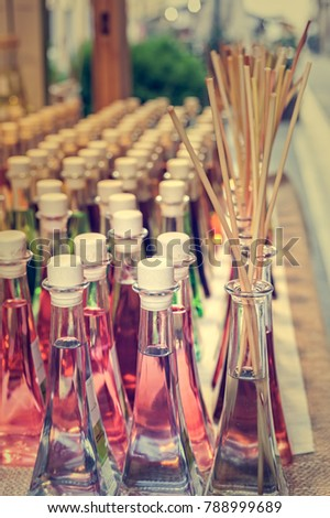 Colored bottles of fragrances with sticks for the fragrance of the house. #788999689