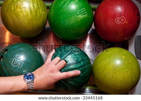Colored bowling balls in the tray
