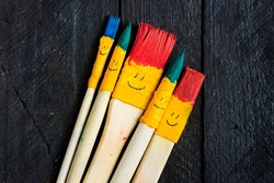 Colored brushes smile fun like a toy family and happy.  Brushes round and his hair colored in blue and emerald.