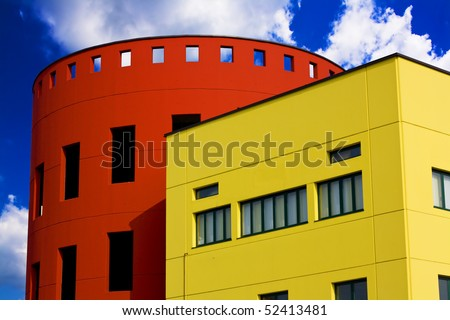 Colored buildings against the blue sky with some clouds