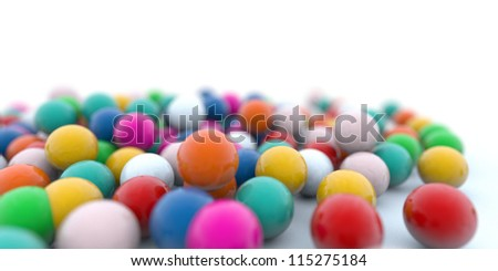 colored candy gum balls on white