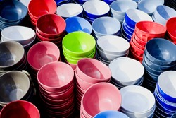 colored ceramic bowls at the market
