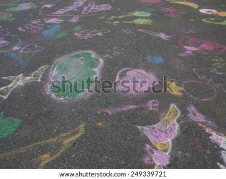 Colored chalks. Colored chalk on playground with drawings on street