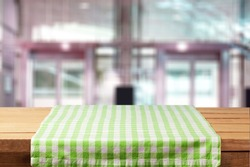 Colored checked tablecloth on wooden table