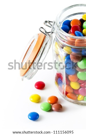 colored chocolate buttons in an old fashioned jar