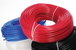 Colored coils of cable on a white background
