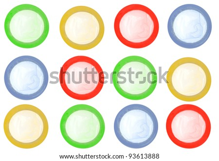 Colored condoms isolated on white background