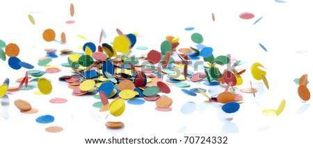 colored confetti falling on white