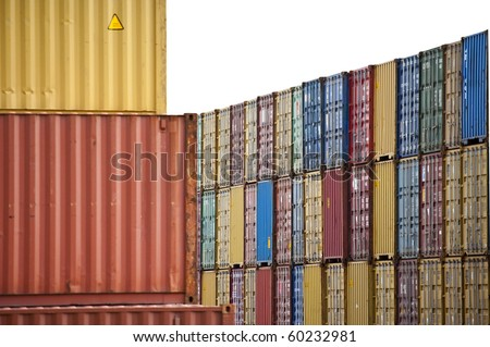 colored containers and stacked waiting to be transported