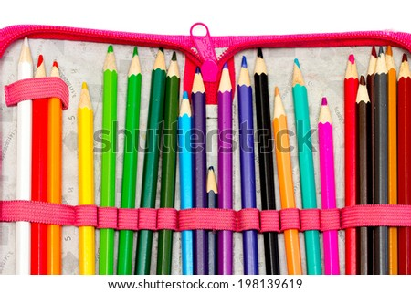 colored crayons on white background