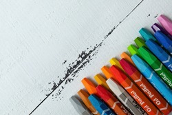 colored crayons with the inscription
