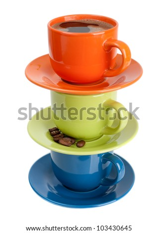 Colored cups of coffee and coffee beans on white background