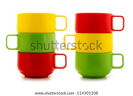 Colored cups on white background