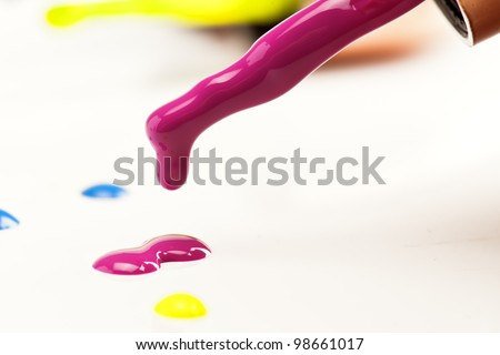 colored drops of nail polish, fall on a white background