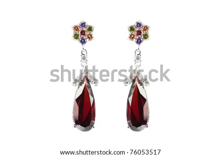 colored earrings on white