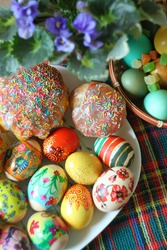 colored easter eggs and easter cake on table