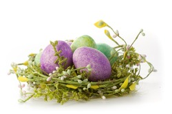 Colored eggs in a easter basket isoliert on white background