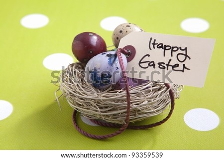 Colored eggs in a small nest with a Happy Easter tag