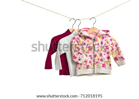 a9ab86b67 Free photos Baby clothes hanging on rope on grey background