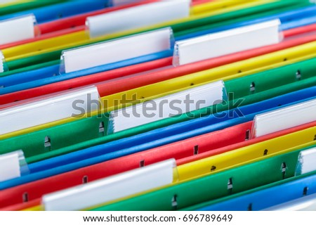 Colored File Folder with Tabs Close Up. #696789649