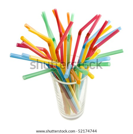 colored flexible straws in the glass  isolated on white background