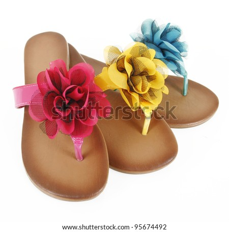 colored flip-flops with flowers