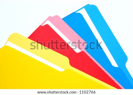 Colored folders on a white background stacked