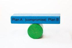 colored fragments in fragile balance with the words Plan A , compromise and Plan B