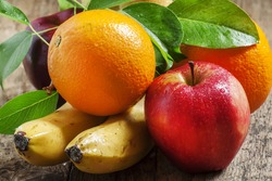 Colored fruits: apple, banana, orange, pear, selective focus