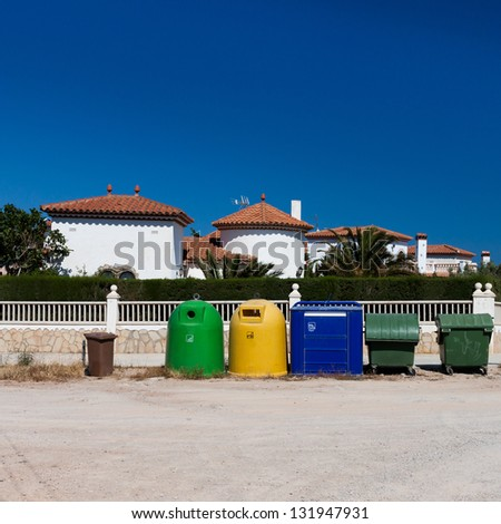 colored garbage bins to help separate and recycle