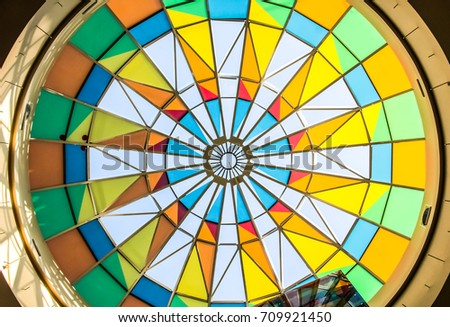 colored geometric dome, mixed color, multi colored roof of a modern shopping center,rainbow colors #709921450
