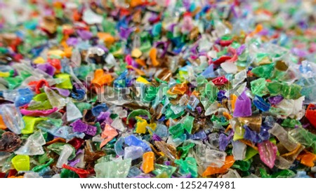Colored granules used in plastic industry.