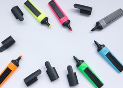 Colored highlighters on a white background.multicolored markers with open caps isolated on a white background copy space