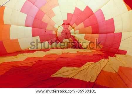 Colored hot air balloon inflated before the departure.